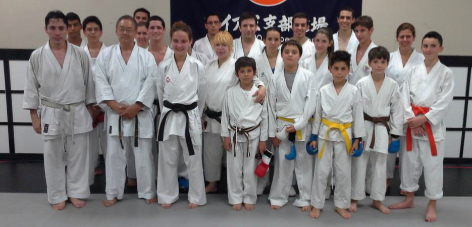 group photo of karate members after a heavy workout